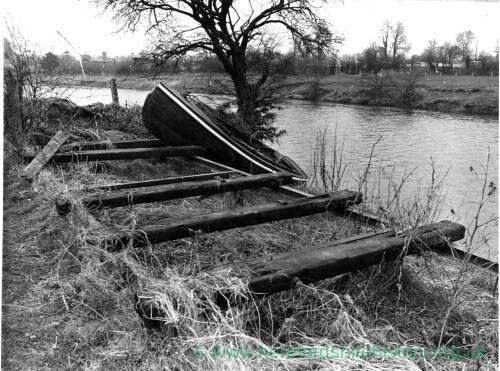 A small rowing boat cast adrift on the River Wye.