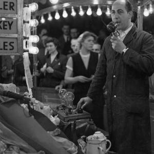 Actor Alfred Marks in charge of the Nail family's Spinner, Hereford May Fair circa 1965.