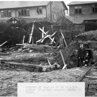 37 De Villiers Avenue, Crosby shelter, showing crater in front, Oct 1940