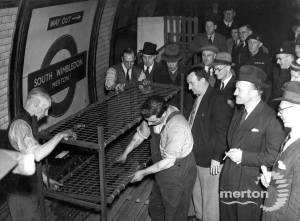 Dismantling of the last bunks provided for use during wartime air raids, South Wimbledon Underground Station