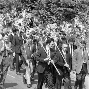 Club members parade through the village of Fownhope for the Heart of Oak Club Walk, 1969