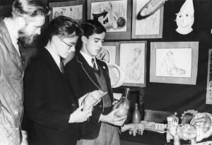 Admiring an exhibition of school artwork