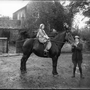 G36-242-06 Young man holding horse with girl rider.jpg