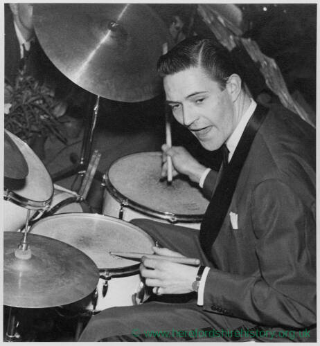 675 - Jack Parnell wearing evening dress & playing drums