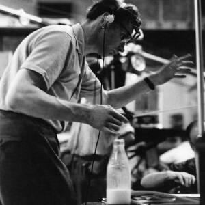077 - Male conductor wearing headphones