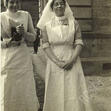 Sister Nicholson, and E.M.W. in Hospital Grounds
