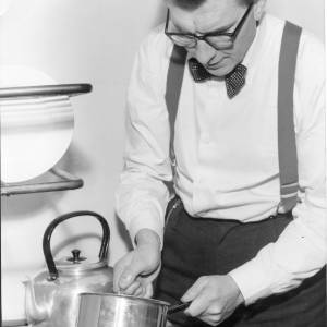 Robin Day cooking in his flat during election fight