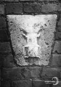 Honefield Road: Keystone depicting a flaming castle