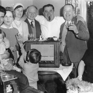 Hereford United staff and family gathered around a wireless for a cup draw.