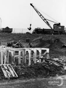 The demolition of air raid shelters, Nelson Gardens, South Wimbledon