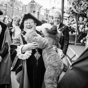 Mayor holding stuffed animal