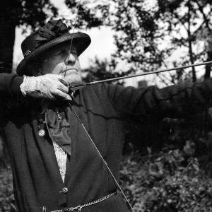 Christine Anne Philips with longbow