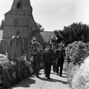 Men in Fownhope churchyard taking part in the Fownhope Heart of Oak Club Walk, 1960