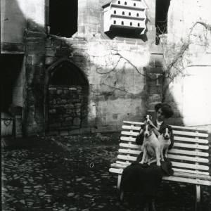 G36-212-06 Brinsop Court, lady seated  in cobbled yard .jpg