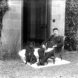 G36-326-14 Gentleman seated outside with dog.jpg