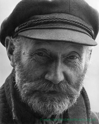 017 - Older bearded man wearing a cap