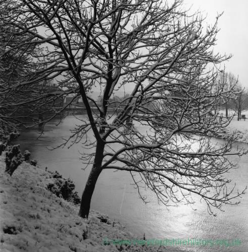 A snowy scene near the Victoria Bridge in Hereford.