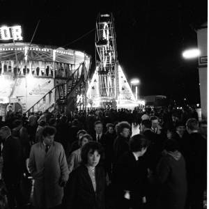 A Girl in the Crowd Beneath the Ferris Wheel at Hereford May Fair, 1965