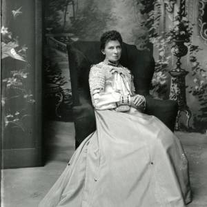 G36-006-15 Lady seated in armchair. Mrs Guy..jpg