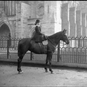 G36-241-12 Young lady on horseback outside Cathedral West Door railings.jpg