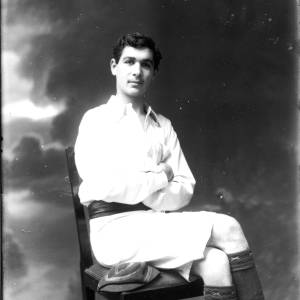 G36-162-12 Young man seated wearing rowing kit.jpg