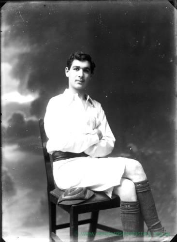 G36-162-12 Young man seated wearing rowing kit.jpg