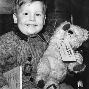A young boy with a teddy bear - 'Found Property'.