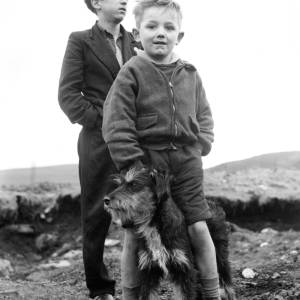 Two boys with terrier type dog.