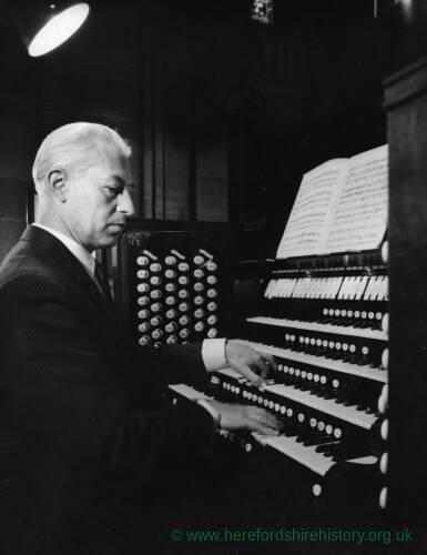 An organist playing the Cathedral organ.