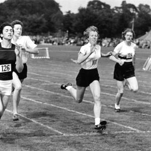 Young women at the climax of a sprint race.