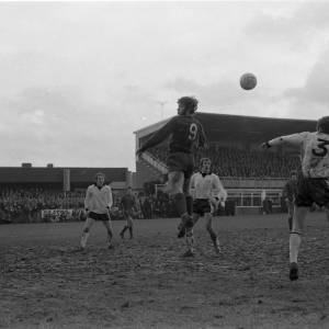 Malcolm Macdonald of Newcastle and Hereford's Ken Mallender in action, Feb 1972.
