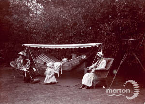 Suffragettes resting in the garden of Dorset Hall, Merton Park