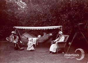 Suffragettes resting in the garden of Dorset Hall, Merton Park
