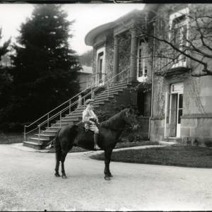 G36-008-01 Small boy on pony in front of imposing flight of steps to first floor of house.jpg