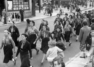 Coronation Celebrations: Mitcham Guides taking part in a local procession