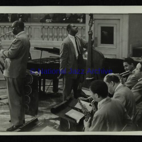 Charlie Fowlkes, Eddie Jones (left to right) and the Count Basie Orchestra
