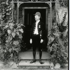 G36-012-07 Man in apparent court dress in doorway.jpg