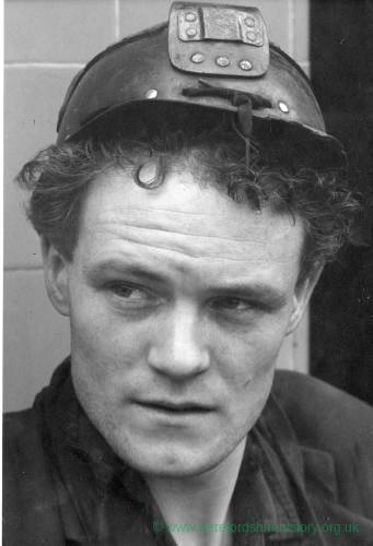 Portrait of miner; young man close up