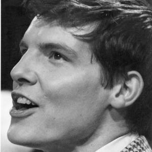 A portrait of pop singer Jess Conrad.