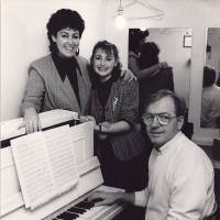Photograph - unknown group of people around a piano