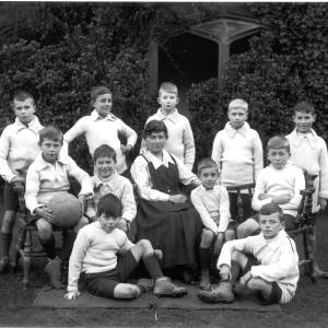 G36-511-03 Hereford Cathedral Prep. School football team with Miss Gamlen.jpg