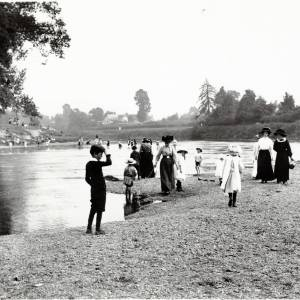 The River Wye below Victoria Bridge, Hereford - children on the River bank and paddling