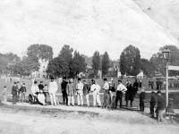 Cricket team and Umpire on Cricket Green