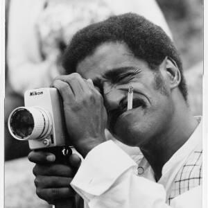 213 - Sammy Davis taking photo with Nikon camera