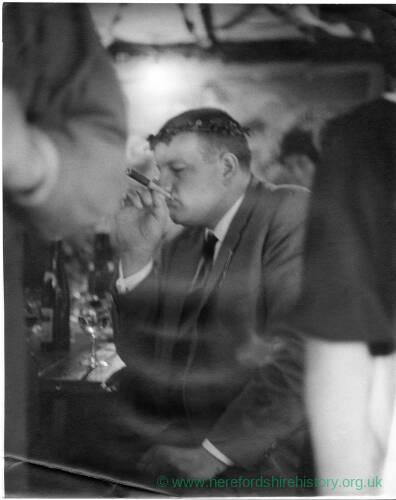 195 - Man smoking cigar in holder