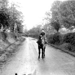G36-324-05 Young boy on pony [as G36-324-01].jpg