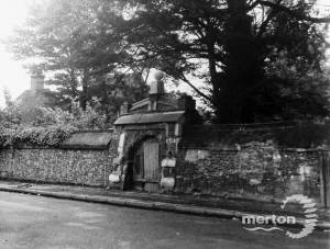 Station Road, Colliers Wood: Merton Priory wall and gateway