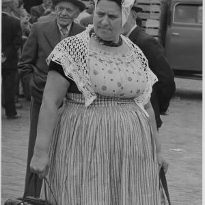 399 - Market scene, lady dressed in costume