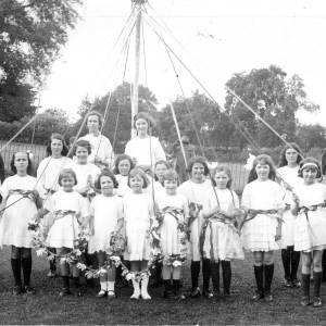 Maypole dancers, Ross-on-Wye, by River Wye