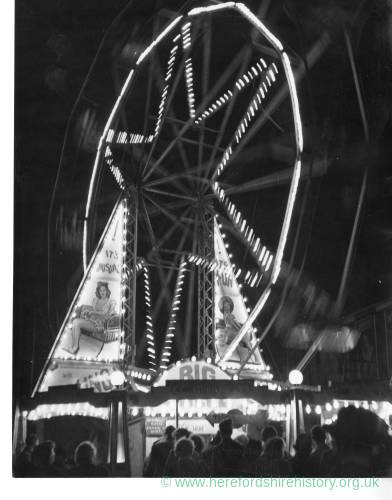 The Big Wheel at Hereford May Fair at night in the 1970s